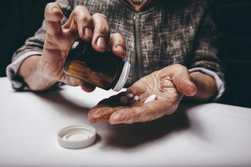 Elderly woman taking prescription medicine