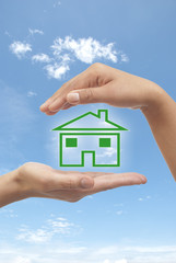 Two hands displaying house