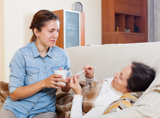 daughter caring for sick mature mother