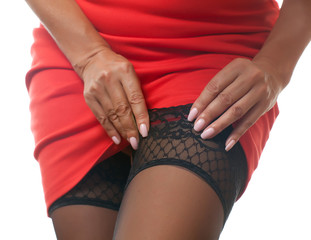 woman straightens stockings