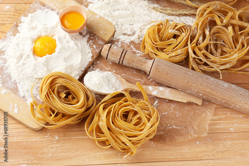 Still life with raw homemade pasta and ingredients for pasta - 68938705