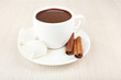 canvas print picture - Cup of hot chocolate on table, close up
