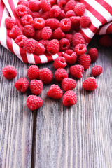 Ripe sweet raspberries on table close-up