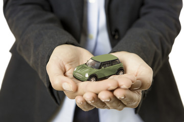hands presenting a toy car