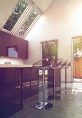 Moderne lichtdurchflutete Küche mit Dachschräge