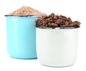 Metal round mug full of seasoning on white background isolated