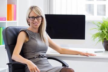 Portrait of young confident businesswoman