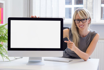 Creative young woman showing blank presentation on screen
