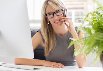 Portrait of successful young woman in her office