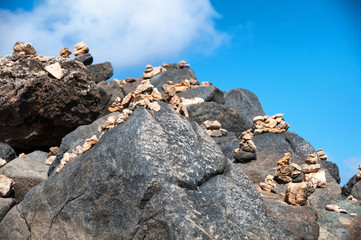 Stone pebbles stacked on the rocks in Aruba