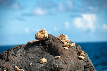 Small cairns and piles of pebbles at the seaside