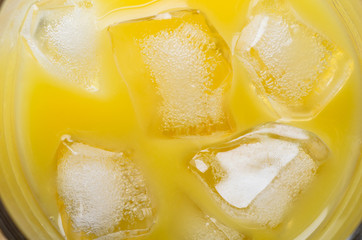 Orange Juice and Ice Cubes Overhead