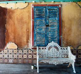 Ornate white wrought iron bench