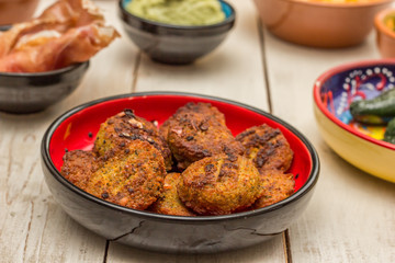 Tapas with falafel, cured ham, green peppers