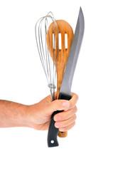 Ustensiles de cuisine en main