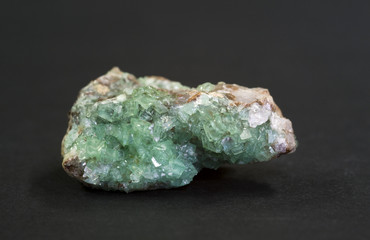 Smithsonite and rare Tsumcorite (brown), Namibia. 5.0cm across
