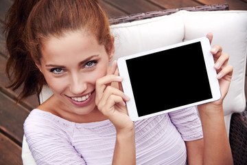 young beautiful woman shows on tablet