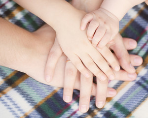 Baby, child, mother, father hands. Family concept