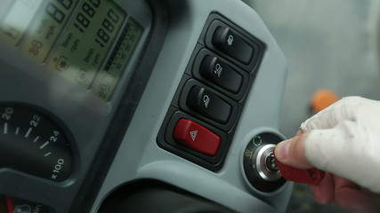 agrarian man turns the key in the ignition and turned on the tra
