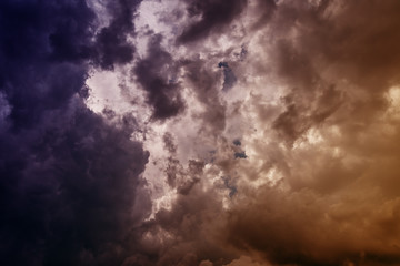 Dark clouds with sky background. Color toned image.