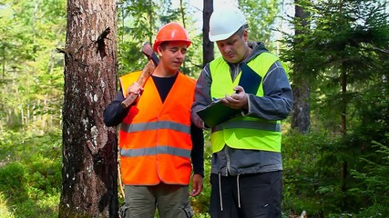 Forest Officer with young worker