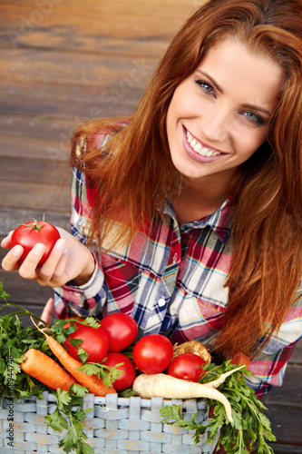canvas print picture beautiful woman with vegetables in the garden