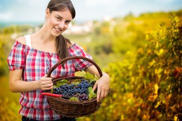 woman with basket full of grapes