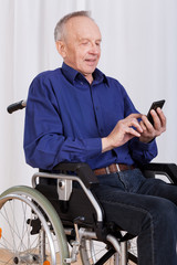 Man on wheelchair sanding text message
