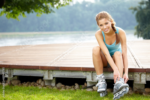 canvas print picture woman skating with rollerblades in a park