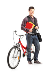 Male student standing by a bicycle