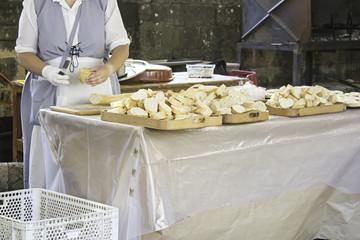 Cook cutting bread