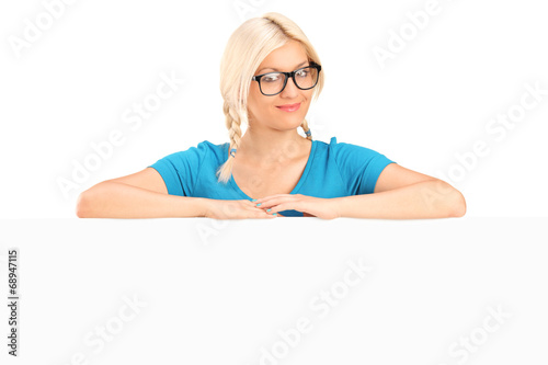 canvas print picture Blond girl with glasses posing behind a panel