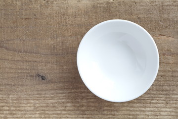 White empty plate on brown wood background