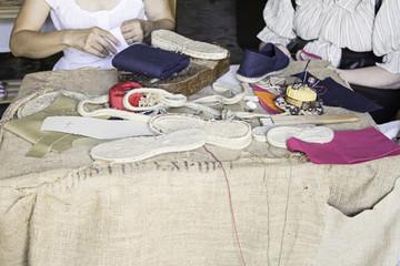 Women sewing shoes