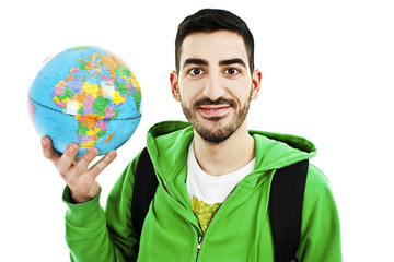 Young traveler with globe on white background
