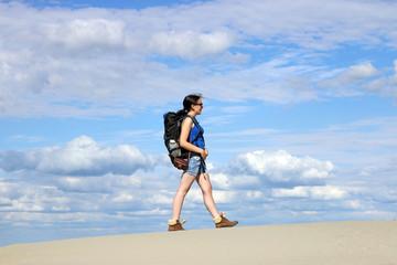 girl hiker walking in the desert