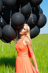 sensual woman with black balloons