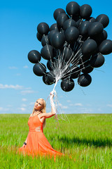 beautiful woman with black balloons