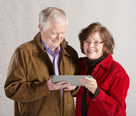 Happy Couple with Tablet
