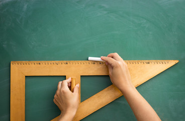 Blackboard and wooden ruler