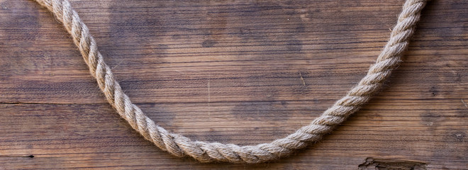 wooden board with a rough texture and a rope