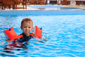 little boy having fun in the swimming pool