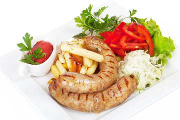 grilled sausages with French fries, sauerkraut and sweet pepper