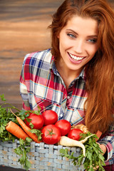 beautiful woman with vegetables in the garden