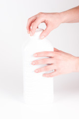 Opening white plastic bottle