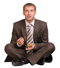 Businessman sitting and hold gold lamp