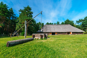 Traditional wooden country hut and well