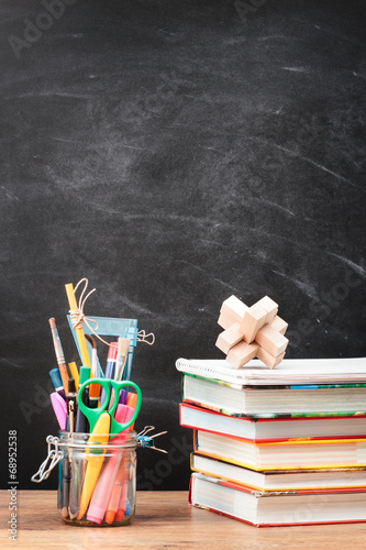 canvas print picture School accessories on desktop with blank blackboard in the backg