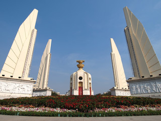 Demoncracy monument under clear blue sky