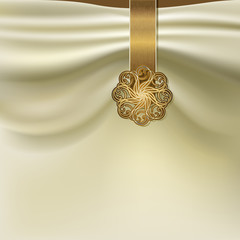 Unusual background with folds of fabric and gold brooch